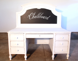Headboard repurposed as a chalkboard for old desk...
